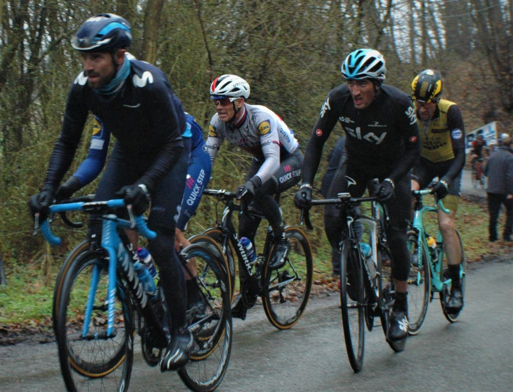 A group of people riding on the back of a bicycle - Road bicycle racing