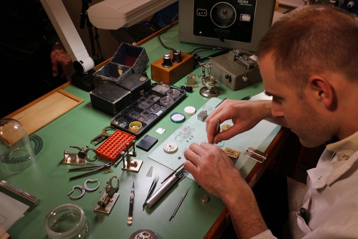 watchmaker assembling a watch