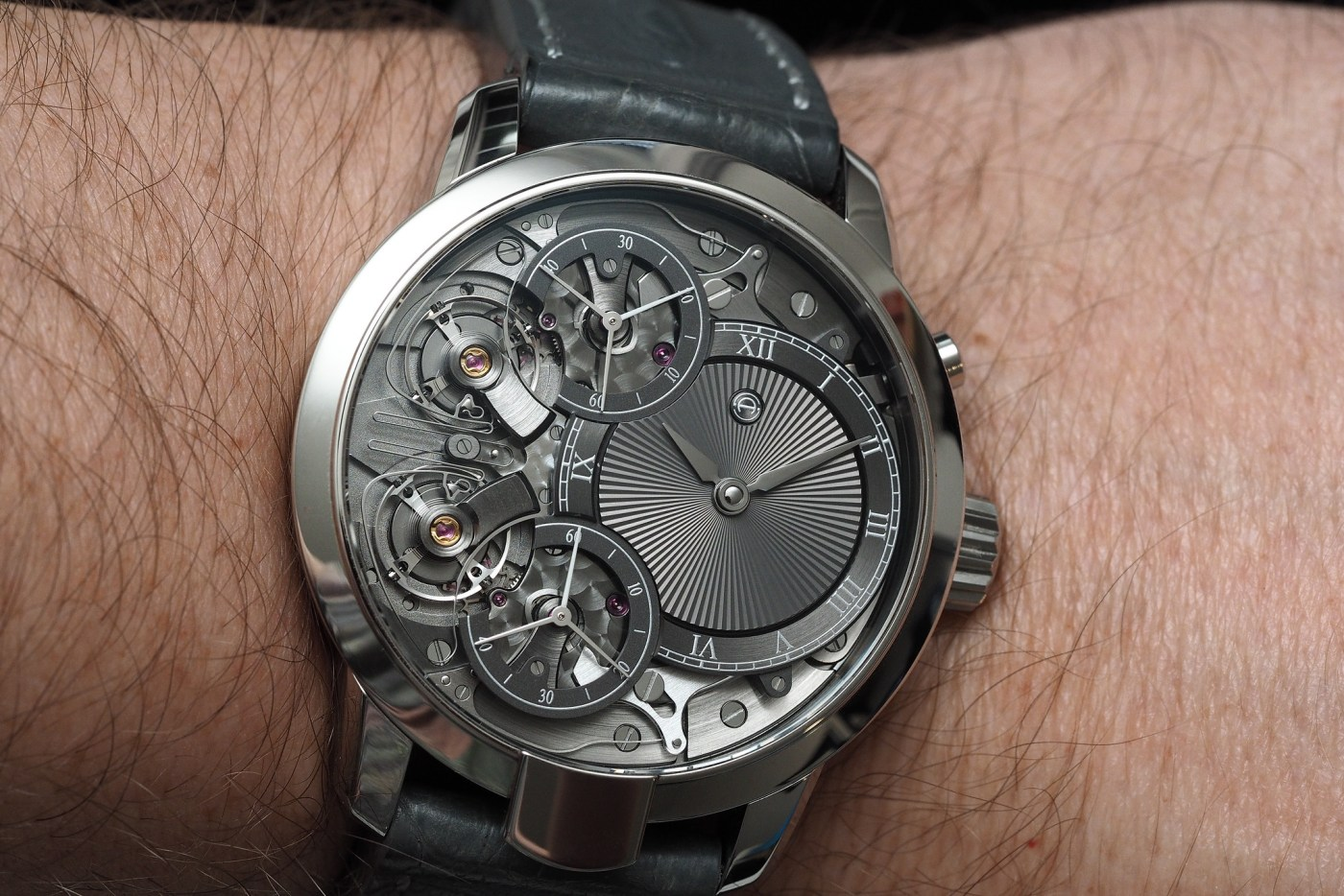 Wristshot of the Armin Strom Mirrored Force Resonance in stainlesss steel