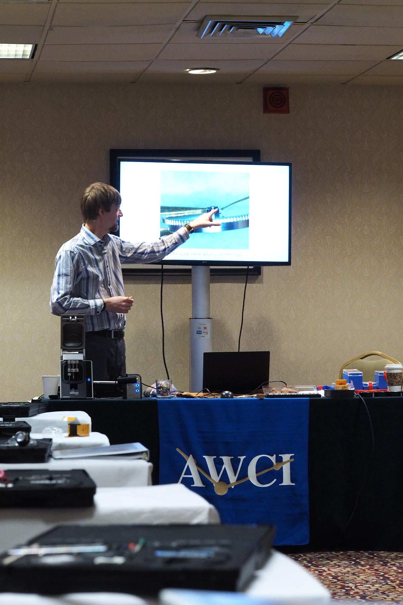 Jordan Ficklin explaining how to oil mainspring barrel pivots