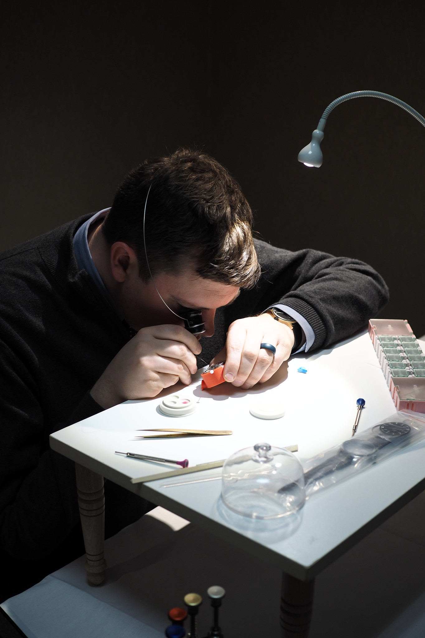 Justin Harell oiling a watch jewel