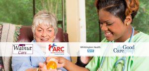 nurse giving elderly woman medicine photograph