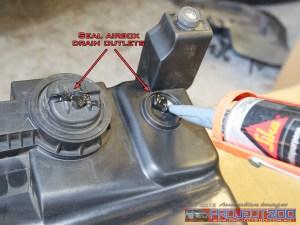 Seal airbox drain sikaflex