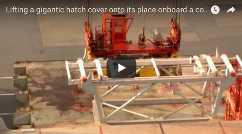 Lifting a gigantic hatch cover into place onboard a container ship.