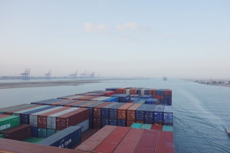 Entrance to the Suez Canal with Port Said Container Terminal on the port side of the vessel.