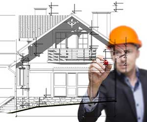 Architect drawing a house