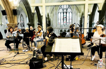 A live orchestra in a modern church