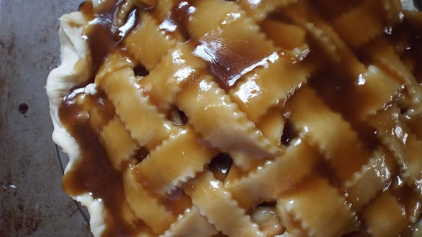 The delicious sauce will not on crisp up the lattice as it bakes, but drip into the pie, coating the apple slices.