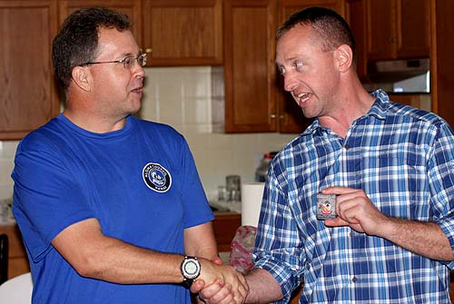Casey giving Bill his CO's challenge coin.