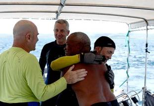 celebrating on board dive boat after finding lost wwii aircraft