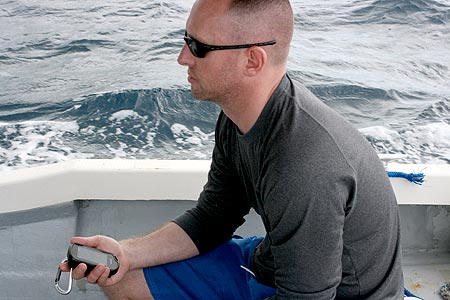 casey using gps to dive site palau