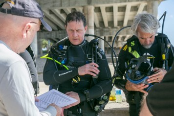 Dan O'Brien giving mandatory safety checklist to divers using technology for search recover of MIA- Photo By Harry Parker Photography