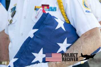 American Legion Officer with flag at Memorial Day Service For Lt. Thomas Kelly. Photo by Harry Parker Photography