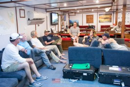 team meeting in the large galley of the Taka Live a Board scuba diving ship - Scuba diving MIA crash sites - Project Recover and BentProp Project are committed to bringing the MIA home. Photos by Harry Parker Photography.com