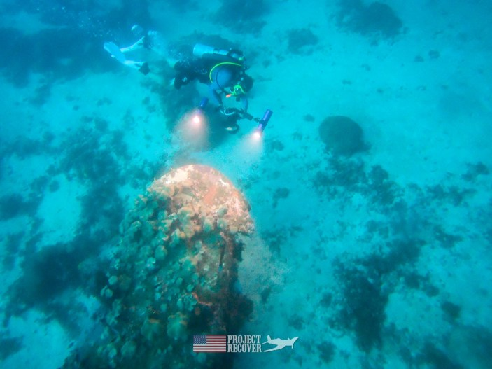 Harry Parker filming for a 3D model of the WWII aircraft Wreck in the Solomon islands while scuba diving mia crash sites. Project Recover and BentProp Project are committed to bringing the MIA home. Photo by Charlie Brown