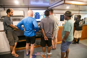 Reviewing sonar image looking for a missing piece of a B24 WWII aircraft wreck during Solomons MIA Search - Project Recover and BentProp Project are committed to bringing the MIA home. Photos by Harry Parker Photography.com