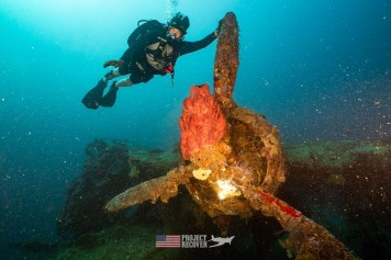 Derek Abbey poses with the Mavis WWII aircraft wreck during Solomons MIA Search - Project Recover and BentProp Project are committed to bringing the MIA home. Photos by Harry Parker Photography.com