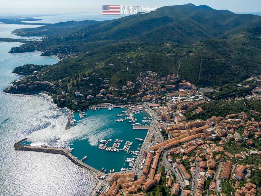 Porto Santo Stefano today, 2019, as a sought out destination for locals and cruises in the Mediterranean. Photo Credit: Harry Parker Photography - Project Recover is committed to bringing the MIA home. Photos by Harry Parker Photography.com