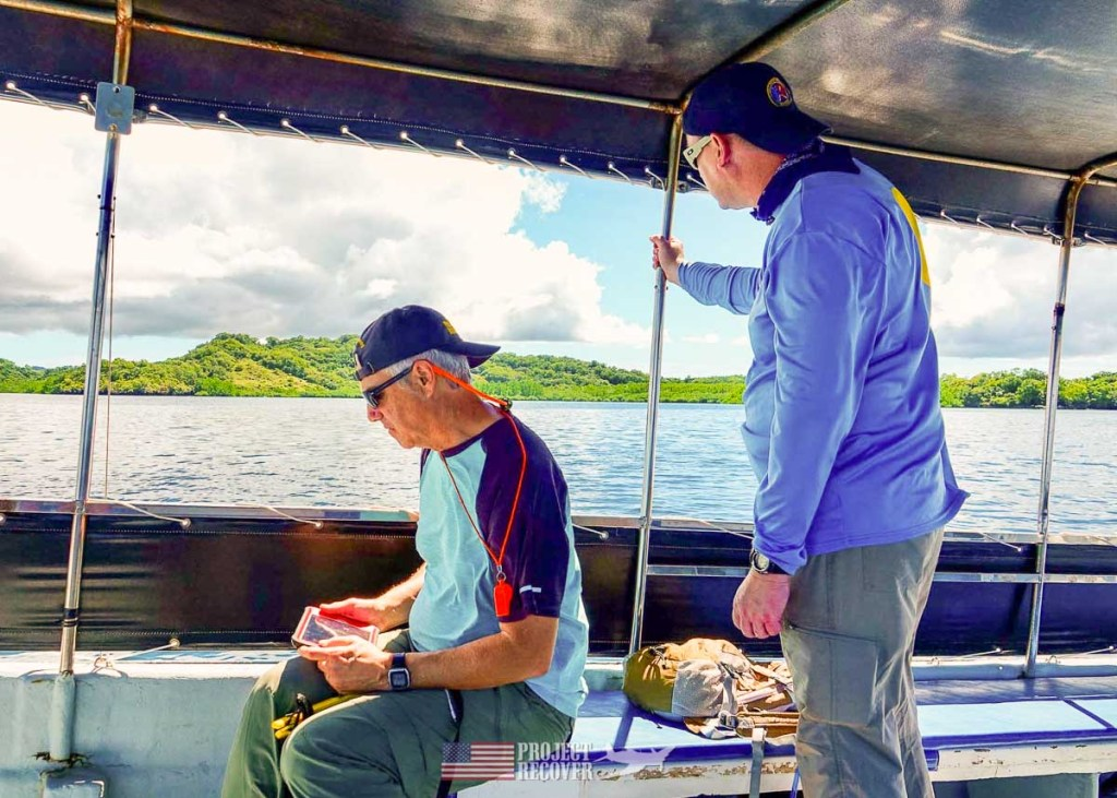 mia search team checking equipment on boat in palau