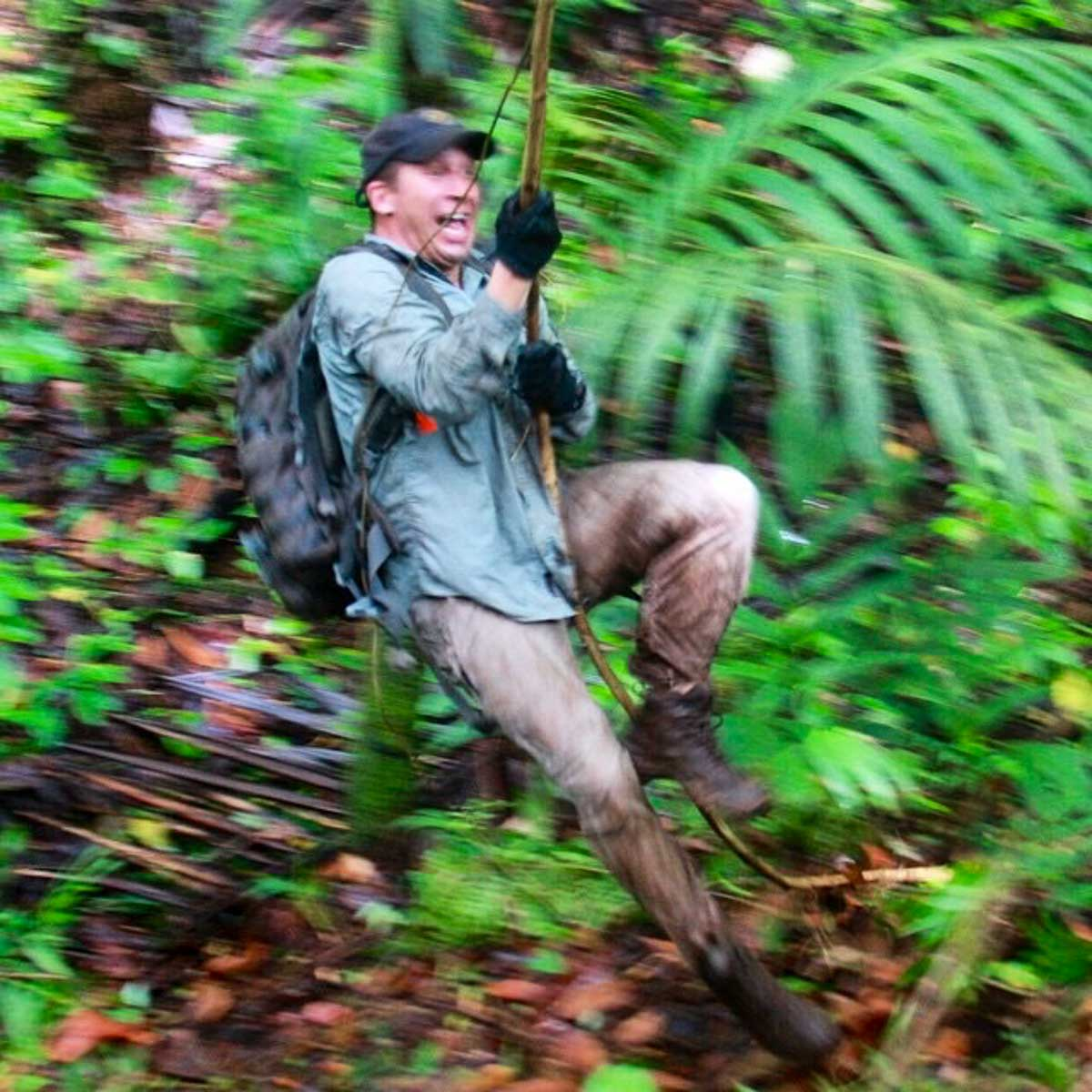 Derek Abbey, Ph.D. Swinging on vine in jungle