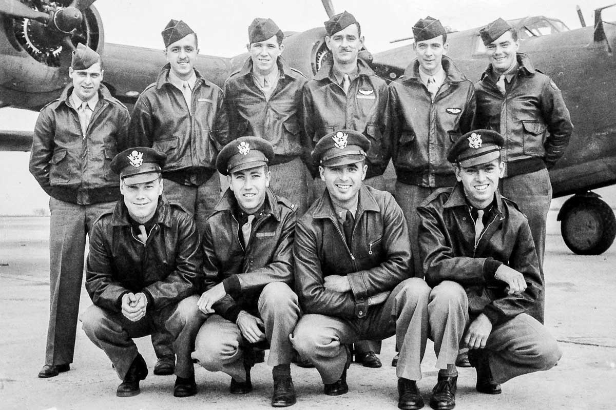 "SSgt Eugene Darrigan with B-24 Bomber Crew of ""Heaven Can Wait"""