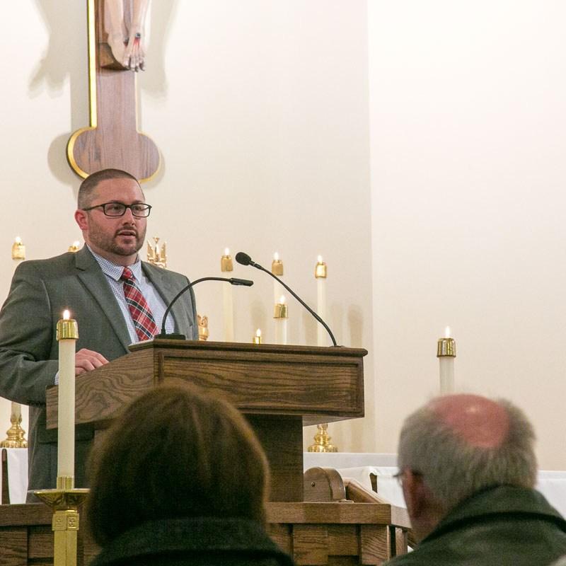 Jim Gray speaking in church at memorial