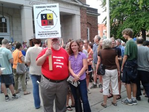 "SARN treasurer Dick Paddock and secretary Anne Wolfley attend the ""Taking the Dream Home to Chapel Hill"" rally in downtown Chapel Hill (August 28, 2013)."