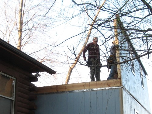 Sliding the upstairs wall into place - Our Classic Manor New Day Cabin - Project Small House