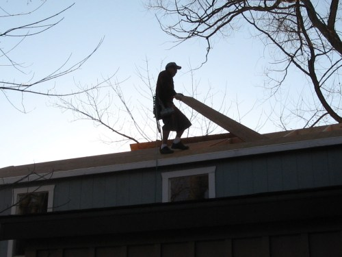 Putting wood on the roof - Our Classic Manor New Day Cabin - Project Small House