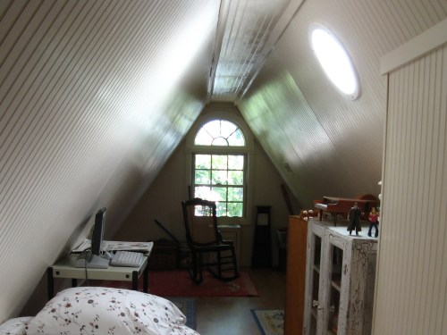 Project: Turning the Attic into a Playroom - Even with no other light, the window and sun tunnels makes this room lovely.