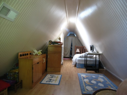 Project: Turning the Attic into a Playroom - There is plenty of room to play. You can see how much light comes in just from the sun tunnels.