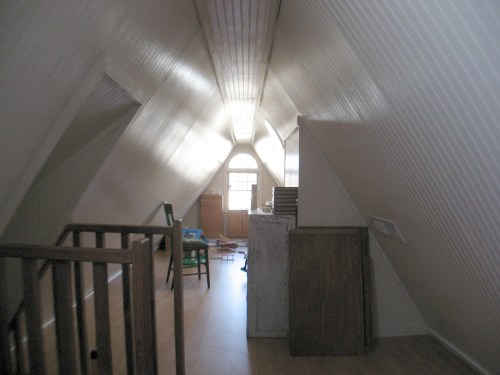 Project: Turning the Attic into a Playroom - There are closable vents at both ends of the attic. The return is in the center by the stairs.