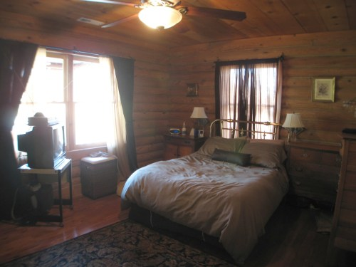 Project: Adding Closets to the log cabin - The only place the bed could fit was under the window.