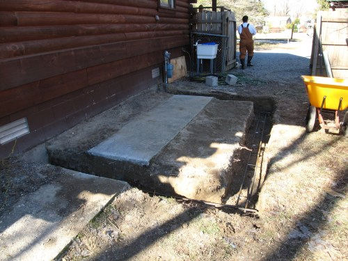 Project: Adding Closets to the log cabin - The footers are dug and the rebar is in.