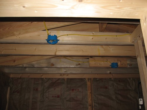 Project: Adding Closets to the log cabin - The closet is framed, insulated and wired for the lights.