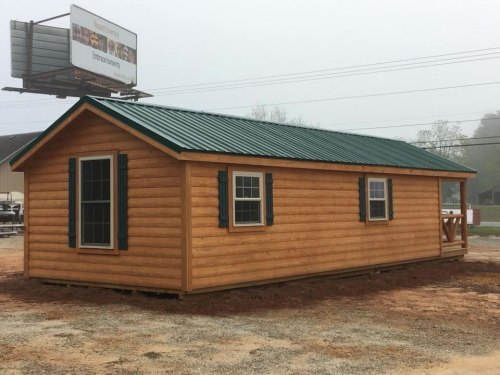 The back of the Modular Log Cabin - Plenty of windows! 12' x 24' Modular Log Cabin for under $10,000 - Project Small House