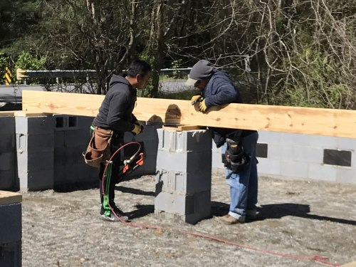 Fitting the joists together on the piers. - Building our Schumacher Home
