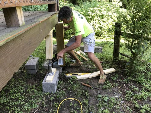 Jacking up the porch to replace the supports - Replacing Deteriorating Log Cabin Porch Supports – Project Small House