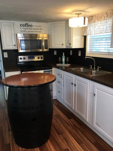 This is definitely not a tiny kitchen! A barrel as a bar? See Inside the Tardis Tiny House – Project Small House