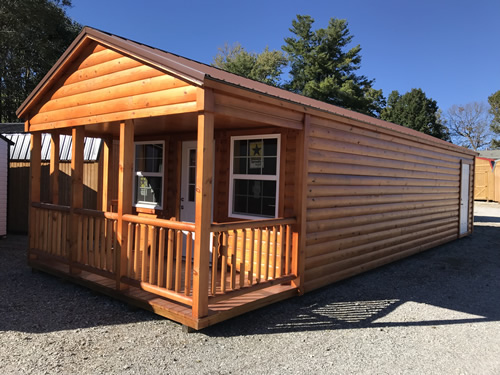 Door in the back, no windows on the sides - Clearance 14 x 38 Log Cabin – Project Small House
