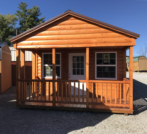 There is a nice peak to the roof and a cute front porch. The porch is 6' x 14'. - Clearance 14 x 38 Log Cabin – Project Small House