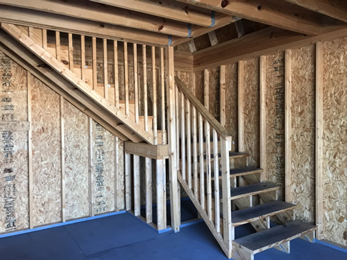 The stairs turn a corner and have a landing. - Summer Wind: Two Floor Storage Barn – Project Small House