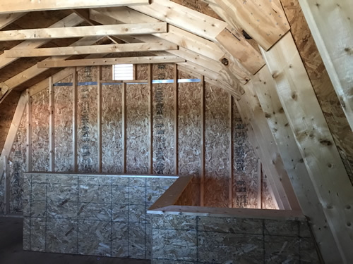 They put a wall around the stairs. - Summer Wind: Two Floor Storage Barn – Project Small House