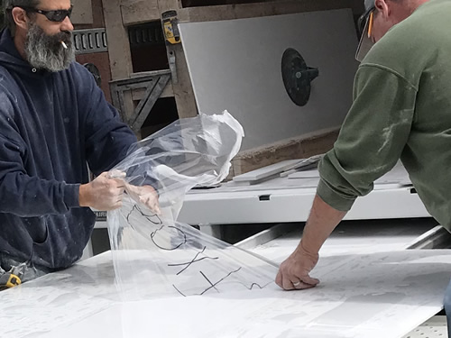 Peeling off the plastic - Cultured Marble Vanity Tops and Tub Surround – Project Small House