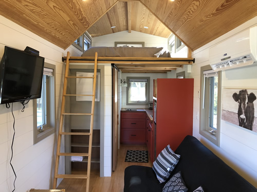 Tiny House with Farmhouse styling has a comfortable sleep loft. This tiny towable is by Red Crown Tiny Homes. - More Photos from the Open House at Acony Bell Tiny Home Village – Project Small House