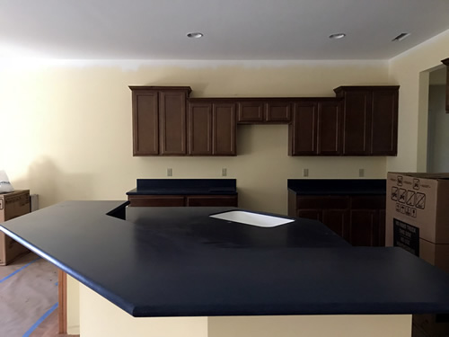 The bar is nice and deep! - Cobalt Blue Corian Countertops in the Kitchen - Schumacher Homes Cross Creek – Project Small House
