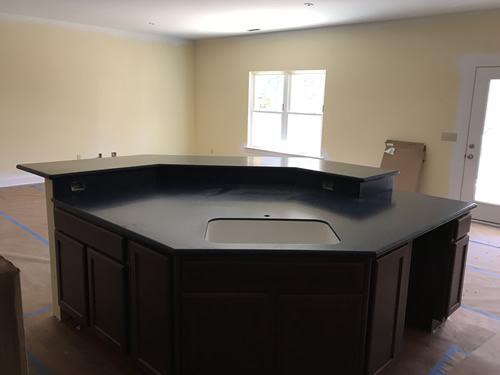 The island and bar - all finished! - Cobalt Blue Corian Countertops in the Kitchen - Schumacher Homes Cross Creek – Project Small House
