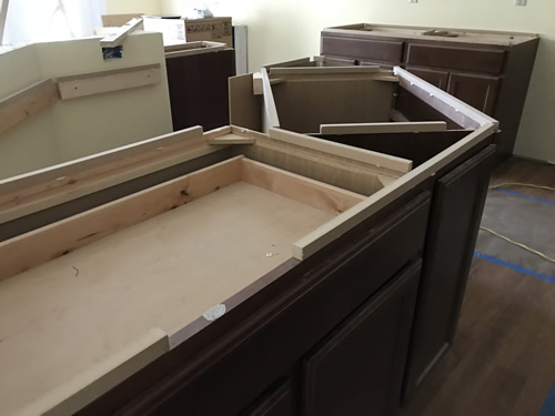 The cut-out for the seam reinforcement - Cobalt Blue Corian Countertops in the Kitchen - Schumacher Homes Cross Creek – Project Small House