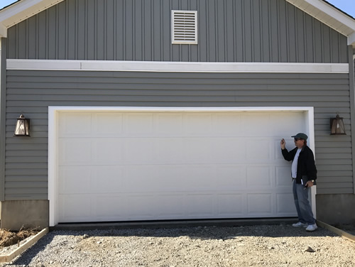 The trim around the garage door is done. - Finishing the Plaster and Paint - Project Small House
