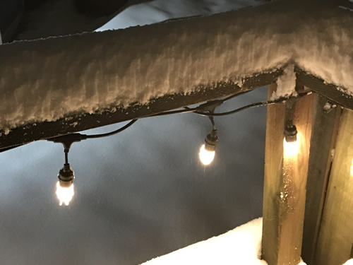 Snow on the rail and LED lights - Snow at Meadowbrook Log Cabin – Project Small House